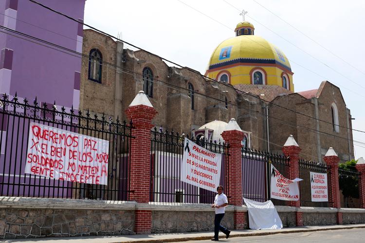 Peritos llegan a Palmarito para indagar video sobre presunta ejecución militar